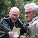 Canadian Ambassador to Ireland Kevin Vickers wrestles with a protester, left, during the ceremony at Grangegorman Military Cemetery, Dublin