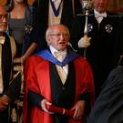 President Michael D Higgins poses for a photograph after he received an honorary degree from the University of Edinburgh