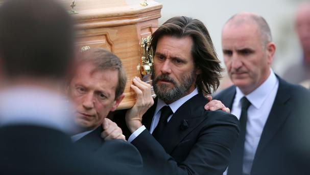Jim Carrey carries the coffin of his ex-girlfriend Cathriona White, in her home village of Cappawhite, Co Tipperary ahead of her funeral