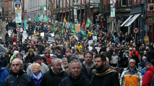Activists take part in a Right2Water demonstration against water charges in central Dublin.