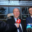 Minister for Sport Shane Ross (left) and Minister of State for Sport Patrick O'Donovan speak to the media outside the Department of Transport, Tourism and Sport
