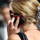 New EU rules on mobile phone roaming will not allow consumers free rein to make calls around Europe without incurring extra fees. Stock Photo