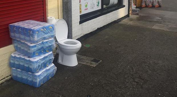 Dublin shop owner Alan Buckley has left a toilet outside his premises