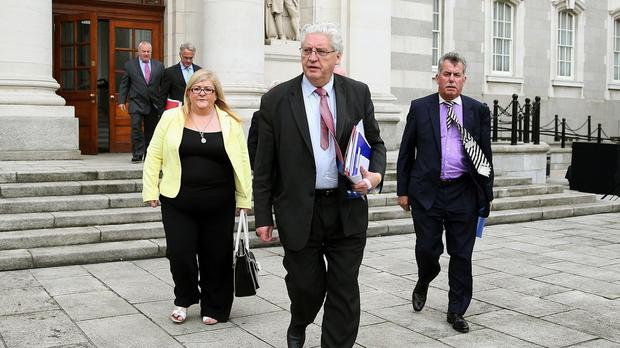 SDLP MP Alasdair McDonnell (centre) says he wants to see the open Border being maintained