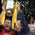 Munster captain Anthony Foley (L) and manager Alan Gaffney celebrate with the Celtic Cup after beating Llanelli Scarlets in May 2005