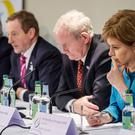 Nicola Sturgeon and Enda Kenny attend a press conference at the British Irish Council summit at the Vale Resort near Cardiff