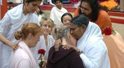 Spiritual leader Amma hugging one of the thousands of people who queued at the Royal Dublin Society halls