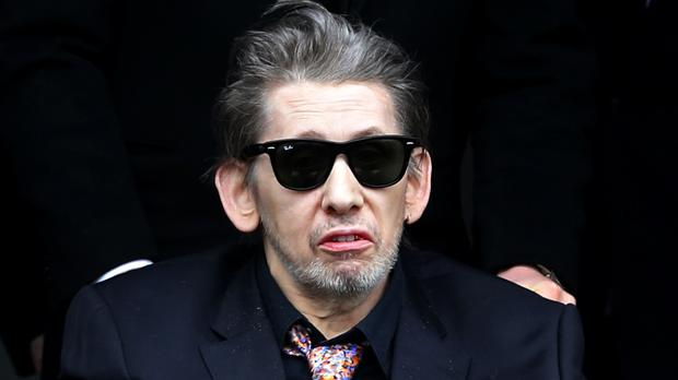 Singer Shane MacGowan is helped from the church as the funeral of his mother Therese MacGowan, 87, takes place