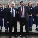 UN Veterans Quartermaster Sergeant Michael Tighe, centre left, and Corporal Tadgh Quinn with pupils from Malahide community school outside Leinster House, Dublin
