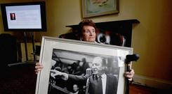 Maureen Haughey, widow of Charles Haughey, holding a portrait of her husband in 2009