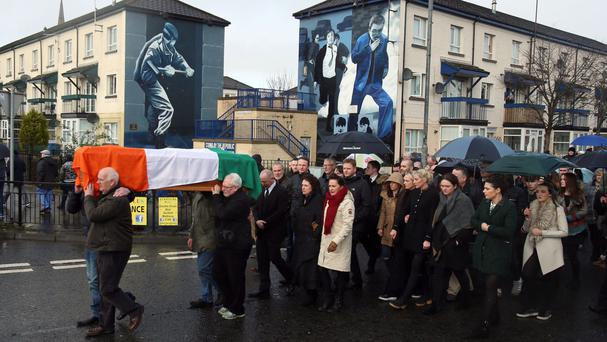 The coffin of Martin McGuinness is carried to his home in Derry after he died aged 66