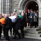 Captain Mark Duffy's body is driven in a hearse accompanied by a guard of honour at Blacksod, Co Mayo