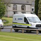 A garda van and an armed support unit vehicle leaving Waterford Courthouse after a 25-year-old man appeared in court charged by detectives investigating suspected Islamic-related terrorism