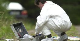 A Garda forensics officer searching for evidence