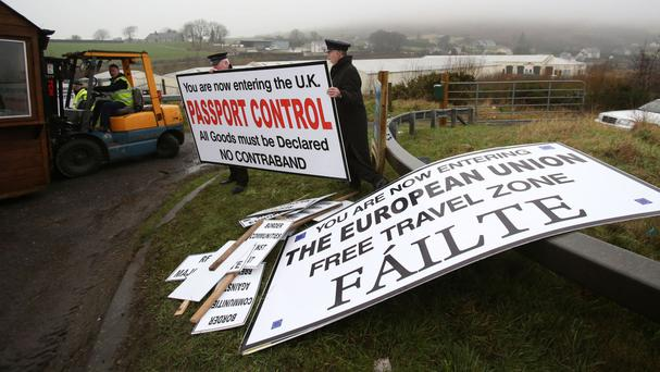 Signs are erected at a mock customs post set up at Ravensdale, Co Louth