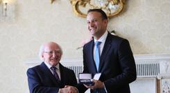 Fine Gael leader Leo Varadkar at Aras an Uachtarain in Dublin as he receives his seal of office as Taoiseach from President Michael D Higgins