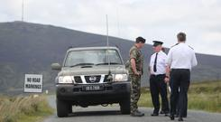 Garda and Defence Forces personnel at the Wicklow Gap in the Wicklow Mountains