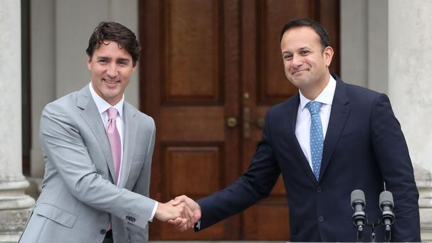 Canadian Prime Minister Justin Trudeau greets Taoiseach Leo Varadkar during a press conference at Farmleigh House in Dublin