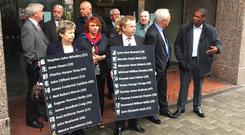 Members of the Birmingham pub bombings campaign group, Justice4the21, outside Birmingham Priory Courts where pre-inquest reviews were held