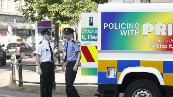 Police officers representative of the gay community in the PSNI and An Garda Siochana arrive for a Gay Pride breakfast at the Northern Whig in Belfast ahead of the Gay Pride parade in Belfast
