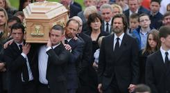 Jim Carrey joined mourners at his ex-girlfriend Cathriona White's funeral in her home village of Cappawhite, Co Tipperary
