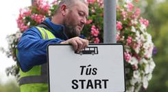 Signs are put up as new traffic restrictions and measures giving priority to buses came into effect in Dublin city