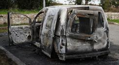 A burnt out vehicle at Verschoyle Green, Tallaght, south Dublin, which Garda believe may be connected with the shooting dead of a man