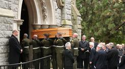 The coffin of former Irish taoiseach Liam Cosgrave is carried into the Church of the Annunciation in Rathfarnham in Dublin, for his funeral service