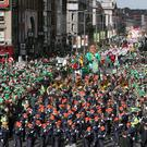 Thousands gather in Dublin city centre for the annual St Patrick's Day Parade but Brexit is already affecting UK visitor numbers, Ireland's finance minister says