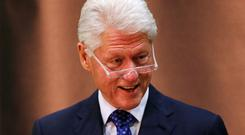 Bill Clinton had been due in the region on Monday to meet the region's warring political parties