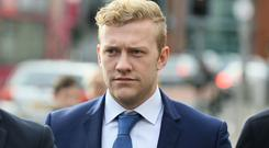 Ireland and Ulster rugby player Stuart Olding arrives at Belfast's Laganside courts