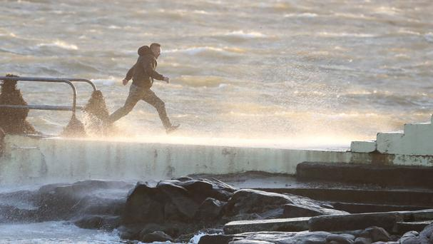 A daredevil runs out to the diving board at Salthill in Galway. An existing 1997 law makes it an offence to recklessly engage in conduct that creates a substantial risk of death or harm to another person. Picture: PA