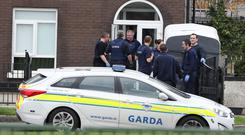 Garda at a property in Brookview Lawns, in the Jobstown area of Dublin, during the manhunt for the gunman