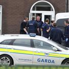 Garda at a property in Brookview Lawns, in the Jobstown area of Dublin, during the manhunt for a gunman