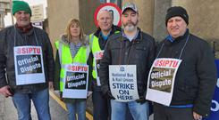 Train driver Martin Fox (left) on the picket line with colleagues from the Siptu and National Bus and Rail Union at Ceannt Station in Galway