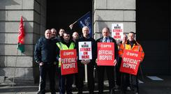 Train drivers and rail workers stage a picket outside Heuston Station, Dublin, during the one-day strike