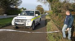 Garda outside a house at The Cottages, Beaulieu, near Drogheda, where a man died and two people were injured after an explosion and fire