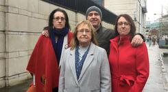 Members of Joe McCann's family, (back row) daughters Aine and Nuala and son Feargal, and (front) widow Nuala outside Belfast Magistrates' Court where two former soldiers accused of murdering the Official IRA commander are asking for their identities to be withheld during court proceedings