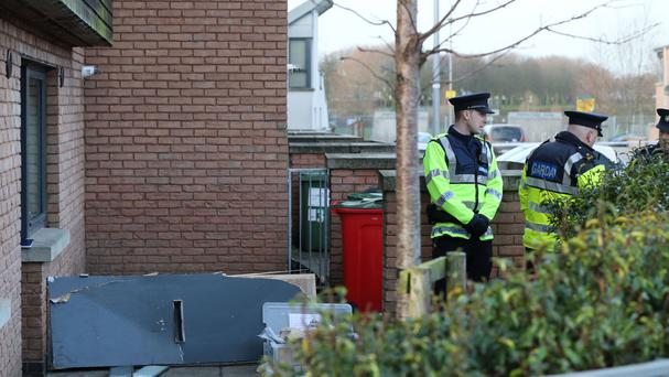 Members of the Garda next to the detached door at the scene in Barnwell Drive, Dublin