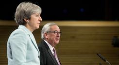 The PM, pictured with EU president Jean-Claude Juncker, said the process of arriving at a withdrawal deal 'hasn't been easy for either side'. (EU Commission/PA)