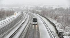 A coach drives through the snow on the M7 motorway in County Limerrick, near Birdhill, Ireland.