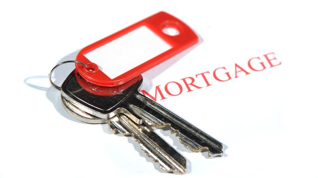 Most mortgage holders who are locked into uncompetitive fixed rates can break free and get a better deal without having to pay a penalty. Stock picture