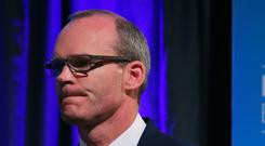 Simon Coveney Simon Coveney blamed tensions around agreeing phase one of the Brexit deal
