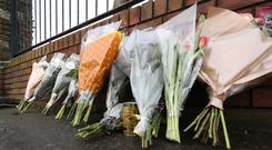 Flowers and a can of Japanese coffee on Avenue Road in Dundalk, Co Louth, close to the scene of the killing of a Japanese man
