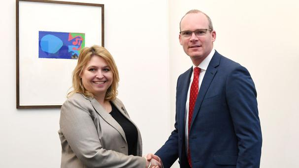 Simon Coveney shakes hands with Northern Ireland Secretary Karen Bradley