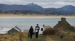 A ballot box is carried away from a polling station after voting concluded on the island of Inishbofin