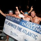 From left to right, Sean Underwood, 25, Patrick O'Connor, 27, Tommy Browne, 28, and Eoin O'Farrell, 26, in Antigua's English Harbour (Ben Duffy/PA)