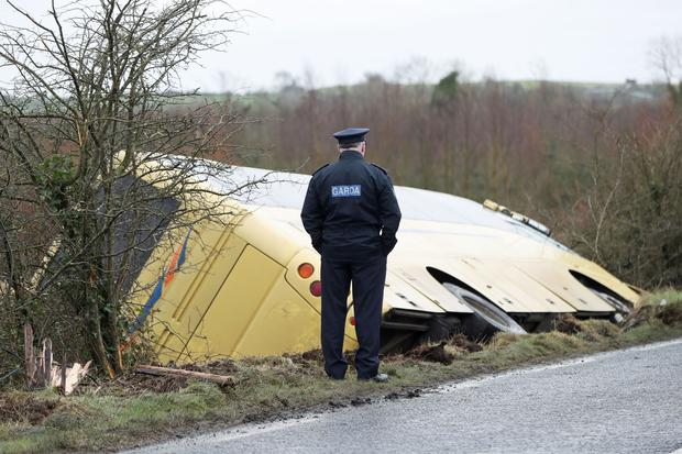 Gardai at the scene where a school bus crashed in Caherconlish