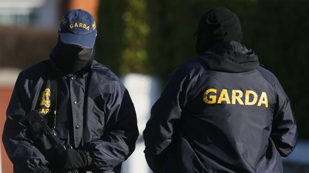 Armed gardai and the Criminal Assets Bureau officers (Niall Carson/PA)