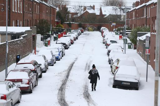 A pedestrian on a snow- covered road in Drumcondra, Dublin